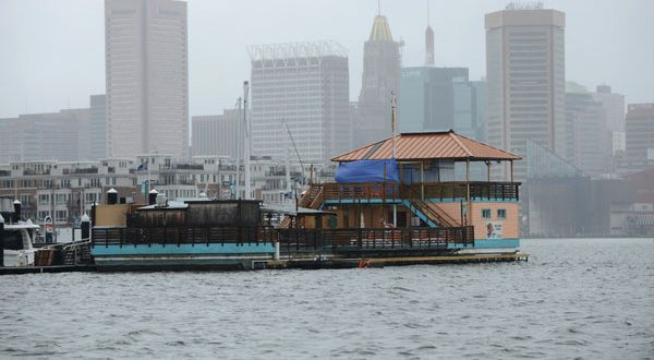 The Tiki Barge (shown with downtown Baltimore in the background) has been a source of concern for the Harborview community, which has cited misbehavior by patrons of the establishment. (The Daily Record/Maximilian Franz)