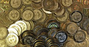 This April 3, 2013 file photo shows bitcoin tokens in Sandy, Utah. (AP Photo/Rick Bowmer, File)