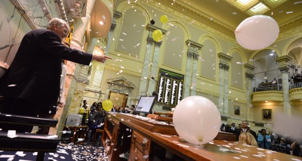 House Speaker Michael Busch points to the crowd of delegates as the confetti dropped at the end of Sine Die 2014 (The Daily Record/Maximilian Franz)