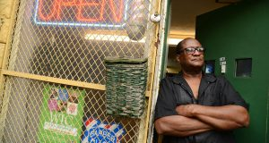 Odell Knox, owner of Knox's Barber Shop on Park Heights Avenue, remembers better days in the neighborhood. (The Daily Record/Maximilian Franz)