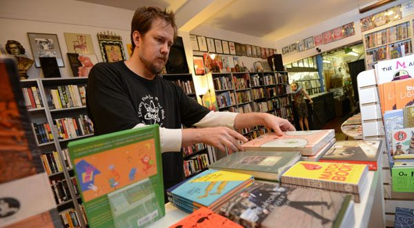 Benn Ray, co-owner of Atomic Books and president of the Hampden Village Merchants Association, says he was unaware of the availability of a tax credit to help provide insurance for his employees. (The Daily Record/Maximilian Franz)