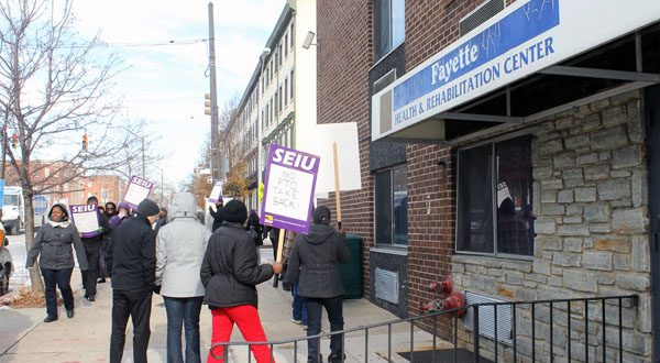 Workers at Fayette Health & Rehabilitation Center, a skilled nursing facility in Baltimore, hold an 'informational picket' in December to protest the proposed labor contract. (Photo courtesy of 1199SEIU United Healthcare Workers East)