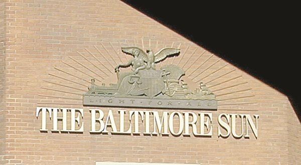 The sign on the Baltimore Sun's Calvert Street offices. (The Daily Record/Maximilian Franz)