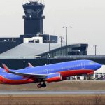 A Southwest plane uses a runway in February 2014 at Baltimore Washington International Thurgood Marshall Airport.(The Daily Record/Maximilian Franz)