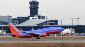 A plane uses a runway in February 2014 at Baltimore Washington International Thurgood Marshall Airport.(The Daily Record/Maximilian Franz)