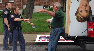 Baltimore County Police speak with Ronald DeJuliis after he and two other men were caught allegedly stealing campaign signs belonging to Sen. Jim Brochin, who is running against the wife of DeJuliis for Maryland Senate. (Photo courtsey Brochin's campaign)