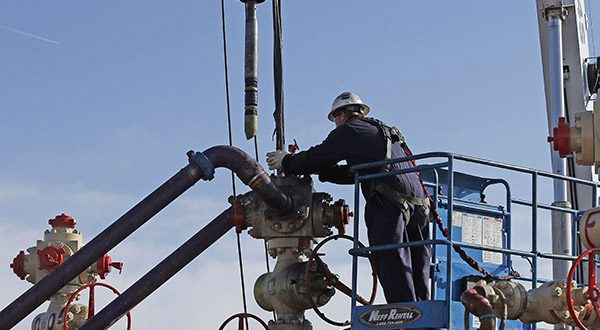Perforating tools, used to create fractures in the rock, are lowered into one of six wells during a roughly two-week hydraulic fracturing operation at an Encana Corp. well pad near Mead, Colo. Proponents of hydraulic fracturing point to the economic benefits from vast amounts of formerly inaccessible hydrocarbons that now can be extracted with hydraulic fracturing. (AP Photo/Brennan Linsley)