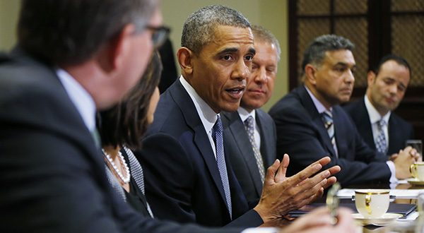 President Barack Obama meets with business leaders about creating and investing in jobs in the U.S. Tuesday, May 20, 2014, in the Roosevelt Room of the White House in Washington. From left are: Carsten Spohr, Chairman and CEO, Deutsche Lufthansa AG; Ravila Gupta, President, Umicore USA; the president; Joe Hinrichs, Executive Vice President and President of the Americas, Ford Motor Company; Sanjay K. Jha, CEO, Globalfoundries; Michael Penner, President, Richelieu. (AP Photo/Charles Dharapak)