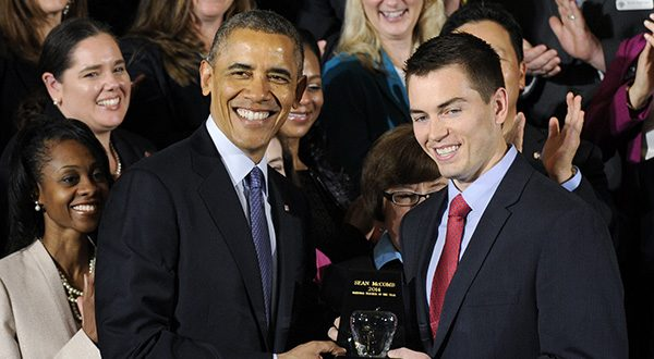 President Obama presents the 2014 National Teacher of the Year Sean McComb, a high school English teacher from Maryland who helps push students toward college, with his award, Thursday, May 1, 2014, during a ceremony to honor the 2014 National Teacher of the Year and finalists in the East Room of the White House in Washington. (AP Photo/Susan Walsh)