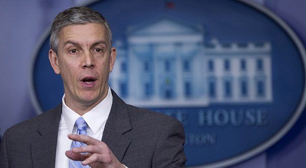 This March 14, 2014 file photo shows Education Secretary Arne Duncan speaking in the Brady Press Briefing Room of the White House in Washington. Student lender Sallie Mae has reached a $60 million settlement with the federal government to resolve allegations it charged military service members excessive interest rates on their student loans. The settlement was announced Tuesday by Attorney General Eric Holder and Duncan. (AP Photo/Manuel Balce Ceneta, File)