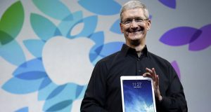 Last year, Apple CEO Tim Cook introduces the new iPad Air in San Francisco. Apple's potential purchase of headphone maker Beats Electronics for $3.2 billion is just the latest example of how much Cook has deviated from Steve Jobs. (AP Photo/Marcio Jose Sanchez, File)