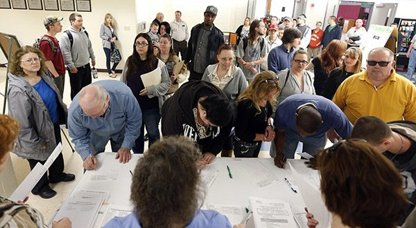 Job seekers line up for a job fair at Columbia-Greene Community College in Hudson, N.Y. The Labor Department reports the number of people who applied for unemployment benefits last week on Thursday, May 1, 2014. (AP Photo/Mike Groll)