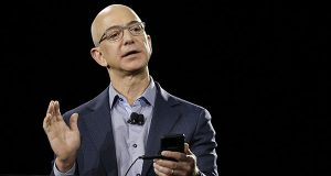 Amazon CEO Jeff Bezos demonstrates the new Amazon Fire Phone during a launch event Wednesday, June 18, 2014, in Seattle. (AP Photo/Ted S. Warren)