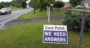 Residents concerned about the Dominion Energy's Cove Point LNG Terminal express their dissatisfaction in signs posted in front of their homes along Cove Point Road, near the facility, in Lusby. (AP Photo)