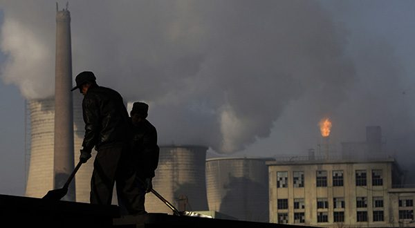 Miners shovel coal at a mine in Xiahuayuan county, north China's Hebei province. (AP Photo/Oded Balilty, File)