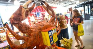 Megan Smedley, a Philadelphia resident in Baltimore for a baseball game, checks out the Old Bay 'Baytique' display within the McCormick World of Flavors store in the Inner Harbor. (The Daily Record/Maximilian Franz)