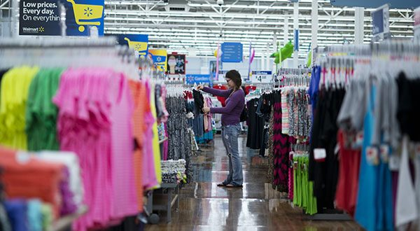 Americans cut back their spending in July, according to a government report Friday. (AP Photo/Sarah Bentham)