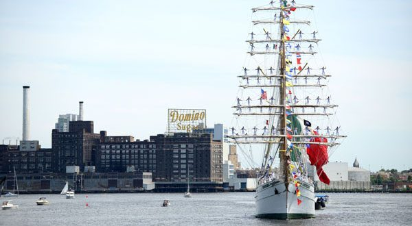A tall ship passes the Domino Sugar plant on its way into the harbor during the 2012 Sailabration. (The Daily Record/Maximilian Franz)
