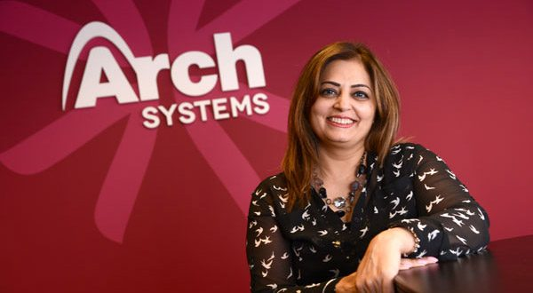 Vini Ehsan, president and founder of Arch Systems, a federal contractor, works at her desk in Arch's offices at Montgomery Park. (The Daily Record/Maximilian Franz)