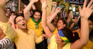 A group of Brazilian students from the Johns Hopkins School of Medicine congregate at Slainte Irish Pub and Restaurant to cheer their nation's team in the opening game of the 2014 World Cup. Slainte's, in Fells Point, is one of many area hotspots for fans of countries competing in the tournament. (The Daily Record/Maximilian Franz)