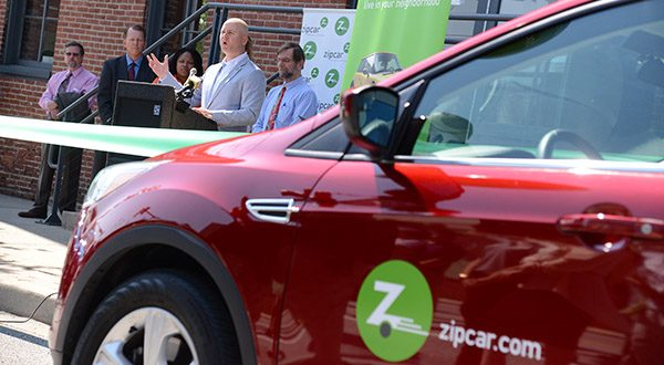 Jeremy Pomp, General Manager of Zipcar's Baltimore office, speaks at the grand opening of the car-sharing company's new location in Harbor East. (The Daily Record/Maximilian Franz)