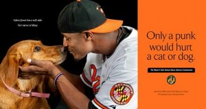 Adam Jones and Missy in poster/billboard for 'Show Your Soft Side,' an anti animal-abuse campaign in Baltimore designed by Sande Riesett of Outlaw Advertising. (Photo by L.H. Lubow, Lubow Photography)