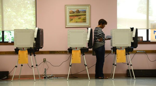 Joanne Scroggins casts her vote at the 4th District polling place in the Randallstown Community Center in June. (File photo)