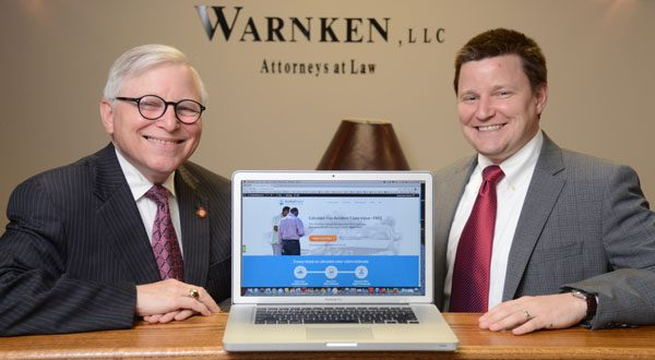The launch of AccidentValues.com was part of Warnken LLC's shift from a criminal-law to a civil-law practice under the founder's son, Byron B. Warnken, right. 'I lack the expertise to do what he does in the accident cases,' says law professor Byron L. Warnken, left, who still handles appeals and post-conviction cases at the firm. (The Daily Record/Maximilian Franz)