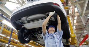 A worker assembles a vehicle on an assembly line at Ford factory in Chongqing, China. By 2020, the automaker hopes Asia Pacific and the Middle East will account for one-third of its sales. The regions accounted for 22 percent of Ford's sales in the latest quarter. (AP Photo/File)