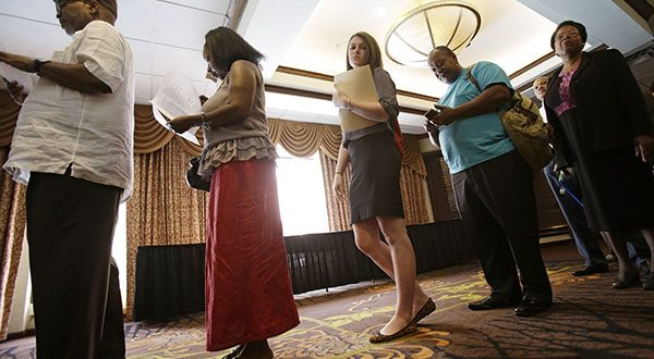 People wait in line for the Cleveland Career Fair in Independence, Ohio. U.S. employers accelerated their hiring in June, adding a robust 288,000 jobs and helping drive the unemployment rate to 6.1 percent, the lowest since September 2008, the Labor Department reported. (AP Photo/Tony Dejak)