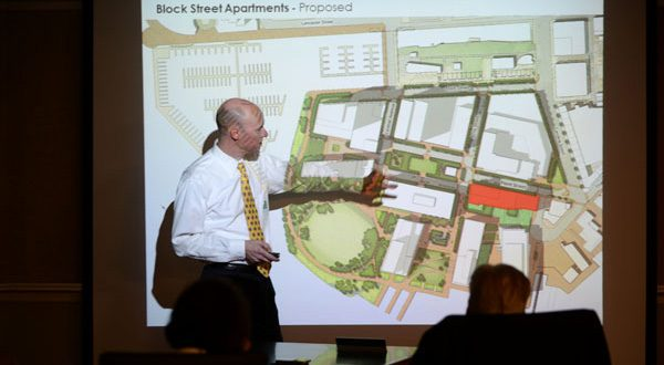 Kevin Johnson, design architect at Ayers Saint Gross, shows schematics Thursday for the proposed apartment project. (The Daily Record/Maximilian Franz)