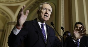 """It would end the absurd practice of American taxpayers bankrolling the outsourcing of their very own jobs,"" said Senate Majority Leader Harry Reid, D-Nev. (AP Photo/J. Scott Applewhite, File)"