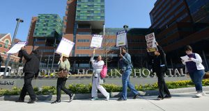 In April, workers at Johns Hopkins Hospital staged a brief strike during their contract talks. (The Daily Record/Maximilian Franz)