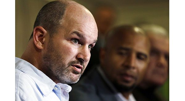 Former NFL player Kevin Turner, left, speaks during a news conference in Philadelphia, as former players Dorsey Levens, center, and Bill Bergey listen. (AP Photo/Matt Rourke, File)