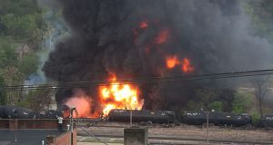 A CSX train carrying crude oil derailed in April in Lynchburg, Virginia, causing a fire and fouling the James River. (Photo: Associated Press by the City of Lynchburg/LuAnn Hunt)