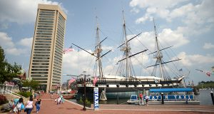 The USS Constellation, docked at Baltimore's Inner Harbor, will be undergoing repairs to its hull and rigging this fall. Chris Rowsom, executive director of Historic Ships, points out some areas of deterioration inside the hull. (The Daily Record/Maximilian Franz)