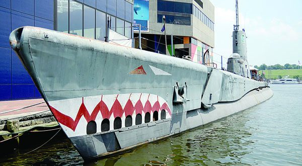 The USS Torsk submarine is docked next to the National Aquarium in the Inner Harbor. The Healthy Harbor Initiative and Blue Water Baltimore released a 2014 report card for the harbor on Thursday. (The Daily Record/Maximilian Franz)