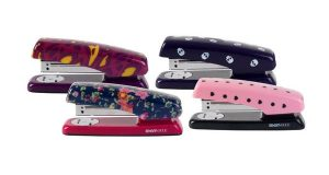 Here are some of the Teen Vogue staplers offered in partnership with Staples. The average family with kids in kindergarten through 12th grade will spend $669.28 on apparel, shoes, supplies and electronics for back-to-school shopping, according to a trade group. (AP Photo)