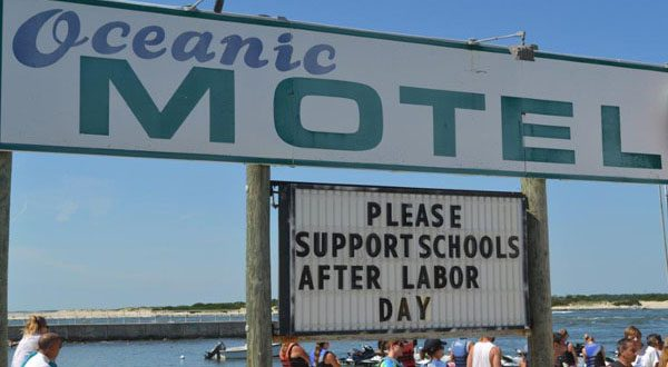 In this August 2014 file photo, a sign in Ocean City calls for the start of school to be pushed past Labor Day. (File The Daily Record/Bryan P. Sears)