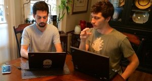 DaoCloud co-founders Eric Green, left, and Max Coleman, discuss development of their holistic health networking site. (Submitted photo)