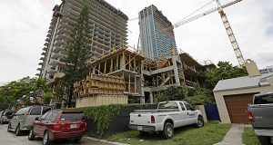 A 36 floor high rise condominium is under construction in Miami. The Commerce Department reports on U.S. home construction in July on Tuesday, Aug. 19, 2014. (AP Photo/Alan Diaz)
