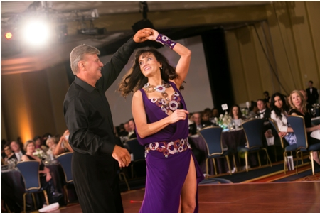 Joe Leskovar (senior male instructor, Towson Dance Studio), who won the 'You're Our Star Award' for being the gala's top fundraiser, and Jean Halle (independent consultant, acting president and chief operating officer of Curiosityville) demonstrate the merengue.