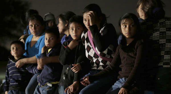 A group of immigrants from Honduras and El Salvador are stopped in Granjeno, Texas, after crossing the U.S. border illegally on June 25. The U.S. government says Maryland has about 2,205 of the unaccompanied children who entered between Jan. 1 and July 7.  (AP Photo/Eric Gay, File)