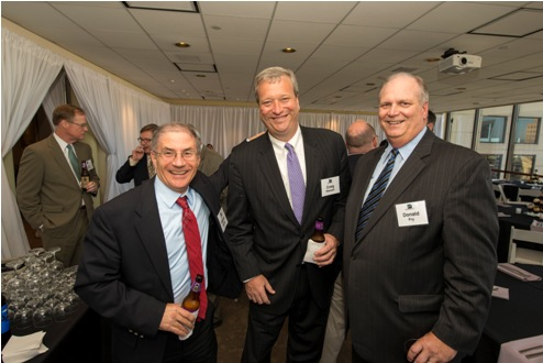 From left, Stephen Sharkey, of DLA Piper, Craig Roswell, of Niles, Barton & Wilmer LLP and Don Fry, of the Greater Baltimore Committee, pose for a photo at the Kornblatt Company's recent 50th anniversary celebration.
