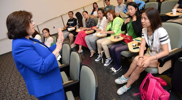 Lynne C. Elkes, an instructor for the Department of Economics, teaches a seminar on capitalism for the students. (The Daily Record/Maximilian Franz)