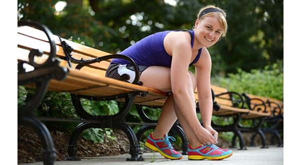 Attorney Natalie Mayo laces up for a run in Towson, part of her training for the Outer Banks Triathlon, which she and her sister will run next month. (The Daily Record/Maximilian Franz)
