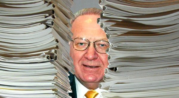 A hearing judge found Neil J. Lewis had 800 open cases during the year he was being investigated by the Attorney Grievance Commission. (Photo illustration by Maximilian Franz)
