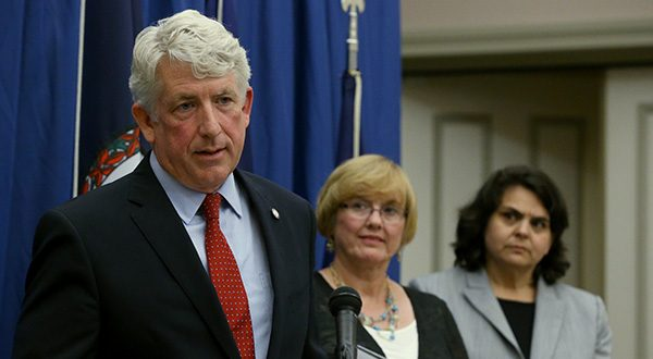 Virginia Attorney General Mark Herring, left, speaks at a press conference Monday, July 28, 2014 at his office in Richmond, Va. Herring spoke about the 4th Circuit Court of Appeals striking down of Virginia's ban on same-sex marriage as Mary Shaw Townley, plaintiff, center, and Rebecca Glenberg, right, with the ACLU of Virginia looked on.  (AP Photo/Richmond Times-Dispatch, Bob Brown).