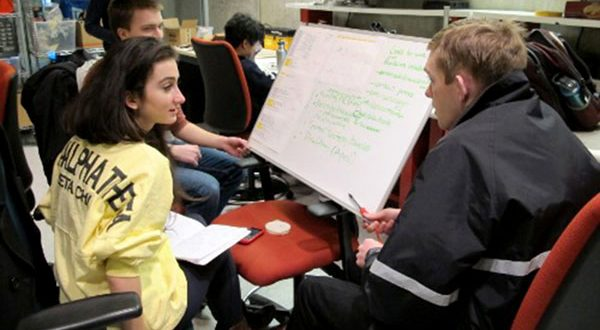 Johns Hopkins University students, from left, Alex Forrence, Tatiana Rypinski and Neil Rens discuss development timelines for their mobile medical diagnostic system. (Submitted photo)