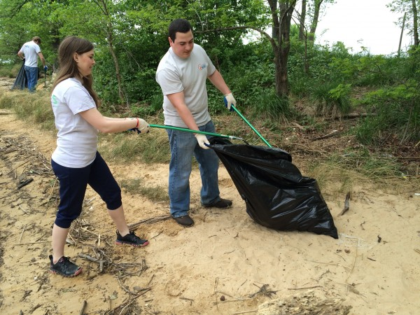 Aileen Farrell, left, and John Malek collect trash along the banks of the Back River in Baltimore County.